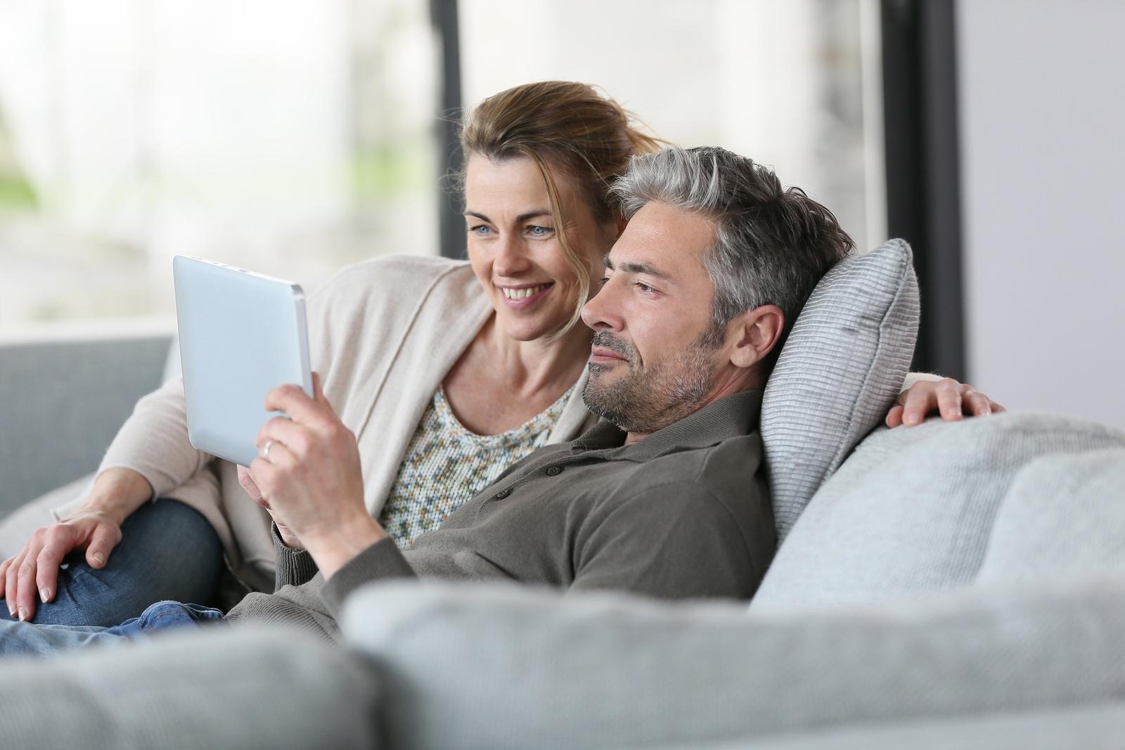 bigstock-Mature-couple-using-digital-ta-87394079